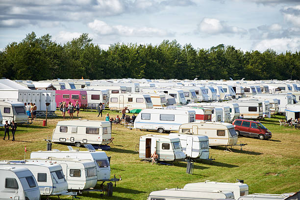 Lots of people have rolled in... Shot of a large caravan park at an outdoor festival trailer park stock pictures, royalty-free photos & images
