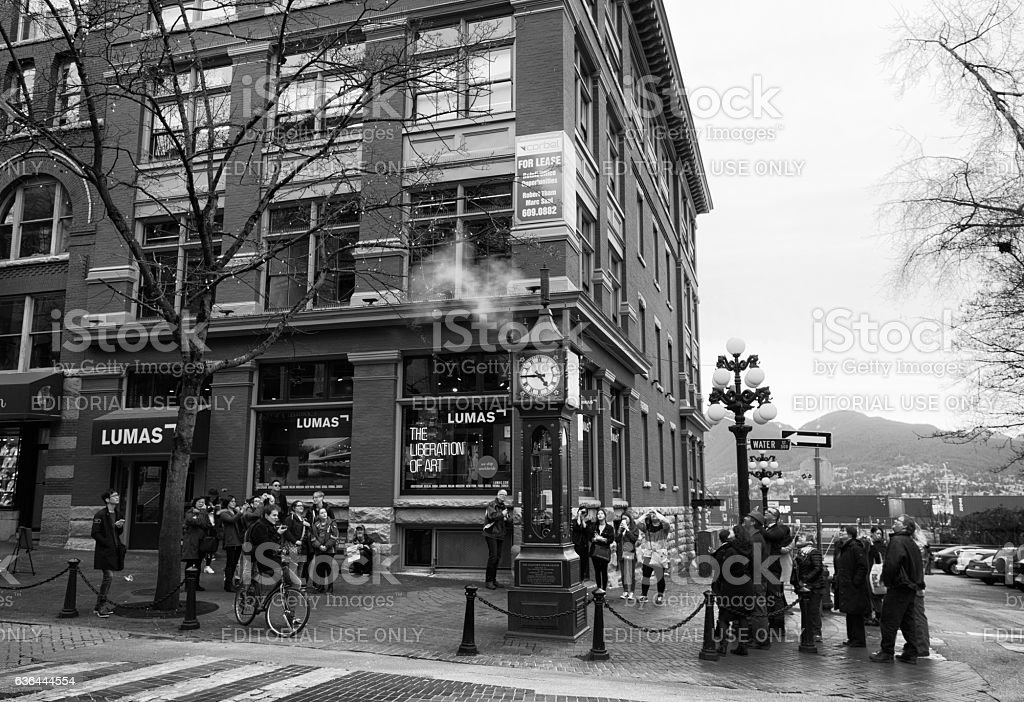 Lots of people watching steam clock at Gastown, Vancouver stock photo