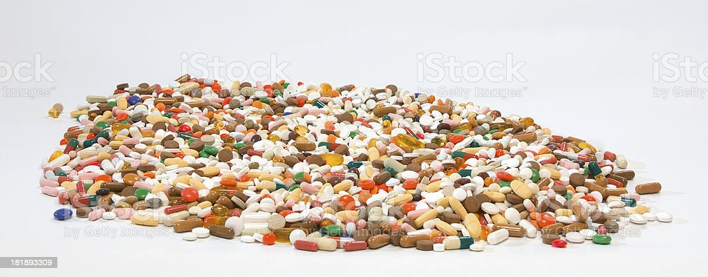 lots of pills on white stock photo
