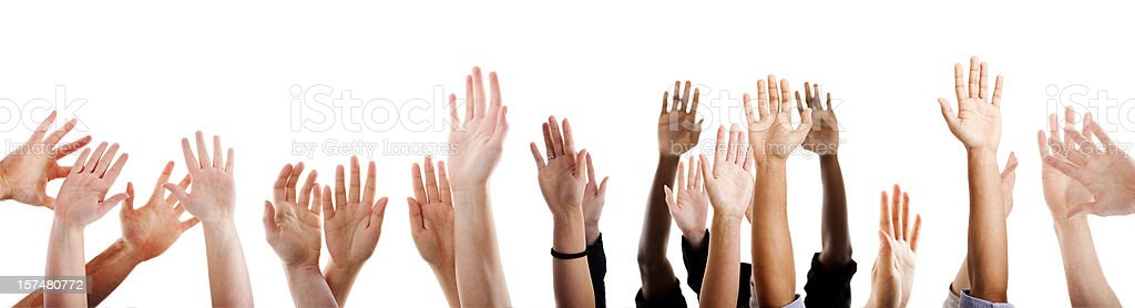 Lots of raised hands stock photo
