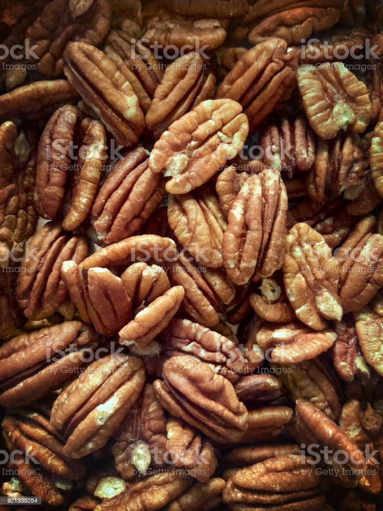 Lots of raw organic pecan nuts. Pecan background. stock photo