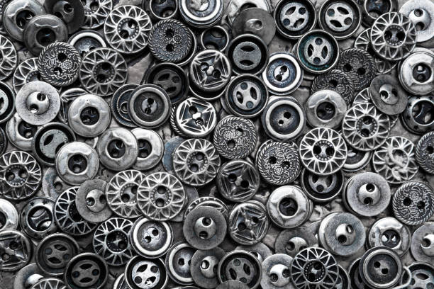 Lots of silvery metal buttons. Steampunk background. stock photo