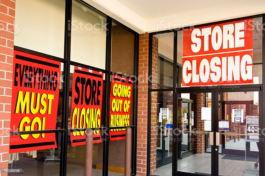 Lots of store closing signs in Windows royalty-free stock photo