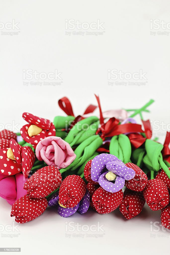 Lots of textile flowers stock photo