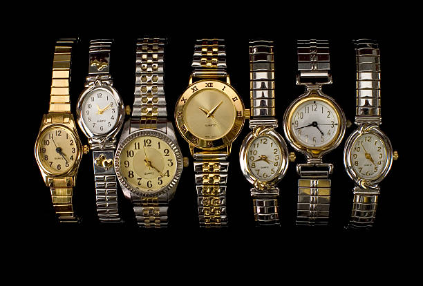 Lots of Time Many watches with different times. luxury watch stock pictures, royalty-free photos & images