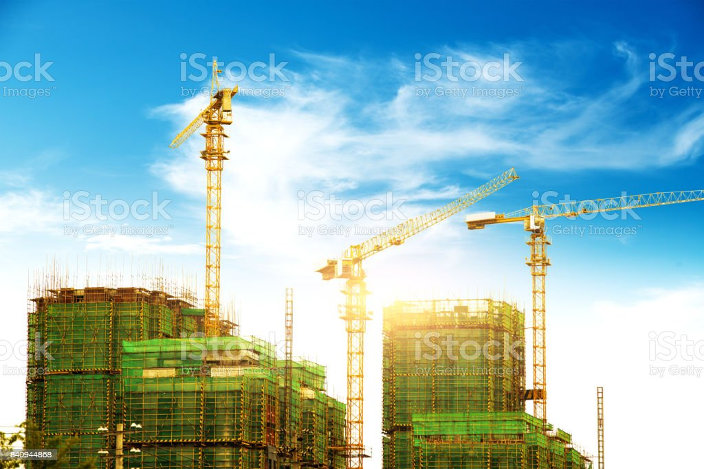 Lots of tower Construction site with cranes and building with blue sky background stock photo
