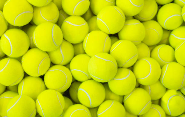 lots of vibrant tennis balls - racket sport stock pictures, royalty-free photos & images
