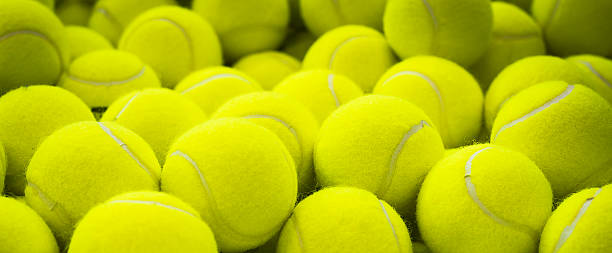 Lots of vibrant tennis balls - Photo