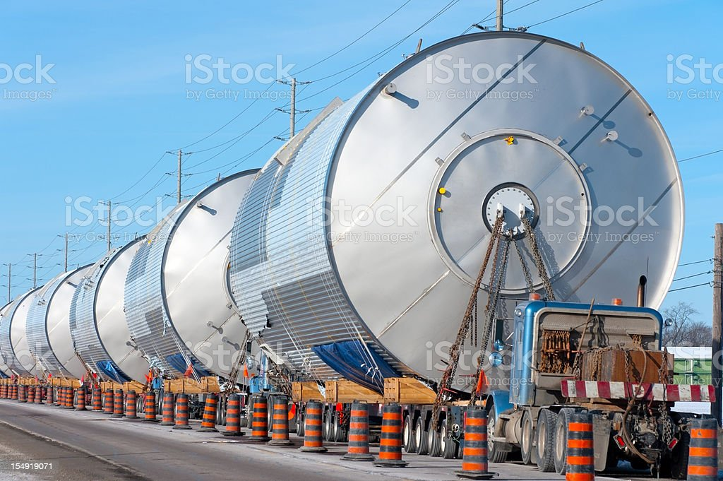lots of wide load trucks parked behind each other royalty-free stock photo