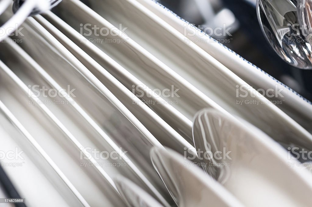 Lots of withe Plates in a dish rack stock photo