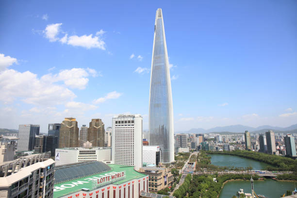 Lotte World Tower of blue sky and sunny clouds stock photo