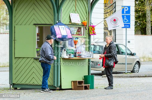 Karlshamn, Sweden - May 06, 2015: Two unknown senior persons outside lottery kiosk in central Karlshamn.