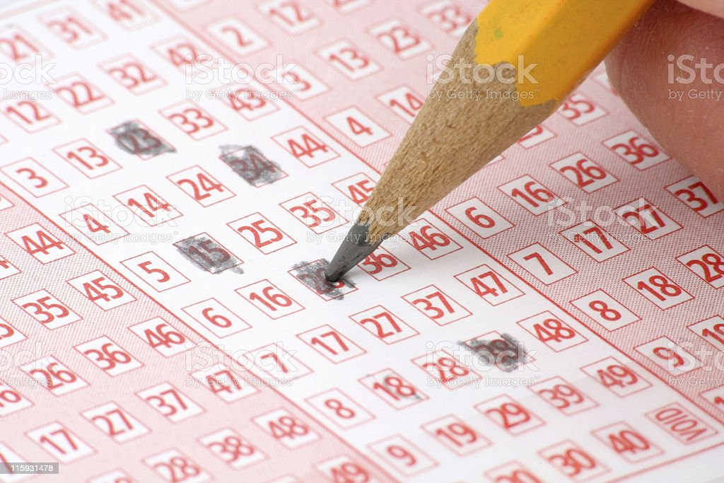 Lottery Ticket and pencil stock photo