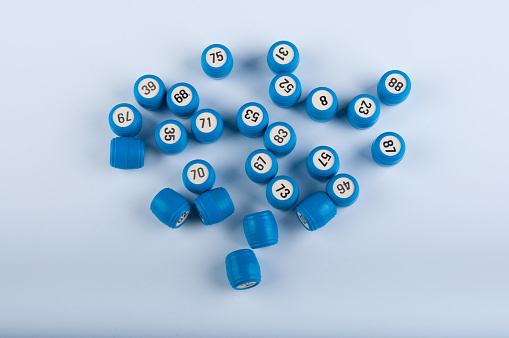 Lotto gane. Blue plastic kegs on white background
