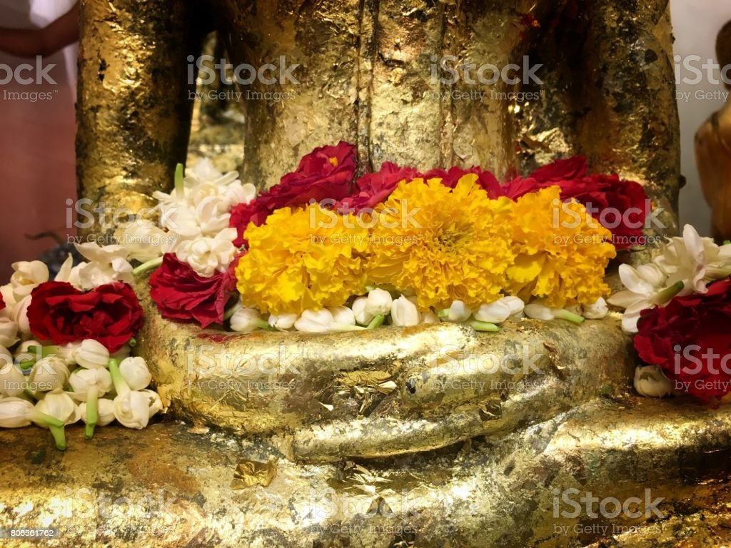 Lotus flower on hand golden buddha statue stock photo istock lotus flower on hand golden buddha statue royalty free stock photo izmirmasajfo