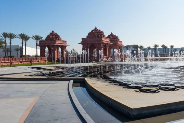 Lotus-Shaped Reflection Pond and Fountain at BAPS Shri Swaminarayan Mandir Hindu temple stock photo