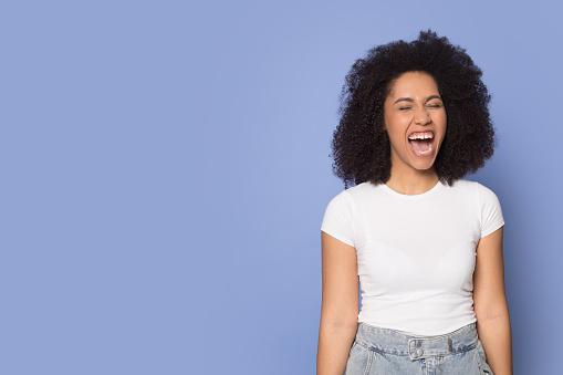 Loud african American millennial girl scream announce sale