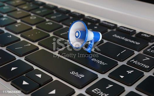 istock Loudspeaker 3d icon on laptop keyboard, 3d rendering 1179633300