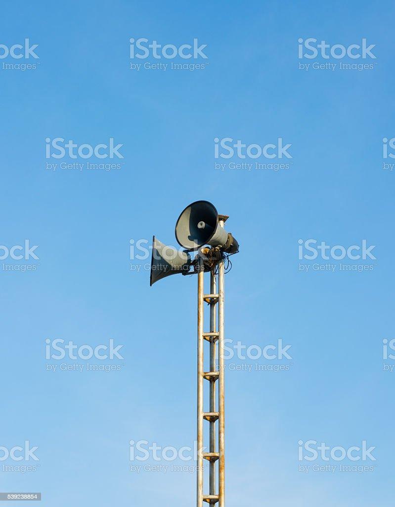Loudspeaker Tower against Blue Sky Background royalty-free stock photo