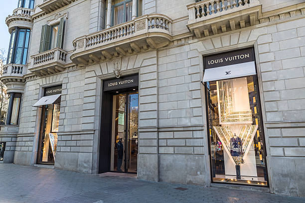 Louis Vuitton, Barcelona Barcelona, Spain - March 27, 2015: Louis Vuitton shop located on Passeig de Gracia, one of the most expensive streets in Europe. gracia baur stock pictures, royalty-free photos & images