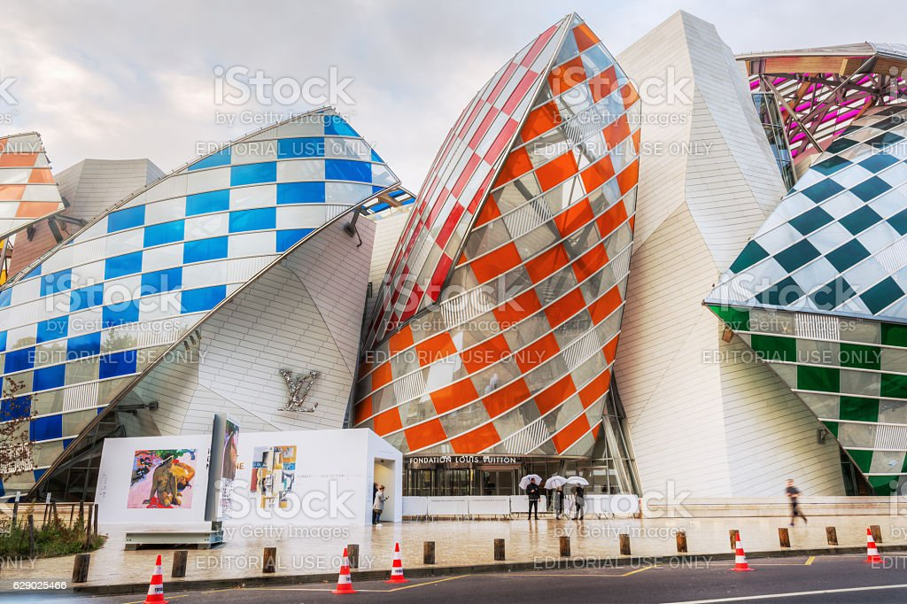 Louis Vuitton Foundation in Paris, France Paris, France - October 20, 2016: Louis Vuitton Foundation in the Parc of Boulogne with unidentified people. It is an art museum and cultural center designed by famous architect Frank Gehry Architecture Stock Photo