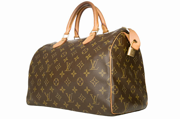 """Louis Vuitton handbag """"Truro, MA USA - October 3, 2012. A Louis Vuitton handbag isolated on white. Louis Vuitton is also called LVMH and has the famous LV monogram. LVMH's headquarter is in Paris, France."""" brand name stock pictures, royalty-free photos & images"""
