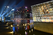 Singapore City, Singapore - February 6, 2015: The Louis Vuitton store at Marina Bay Sands. Crowd of people gather to view the laser show at Marina Bay Sands, Singapore.