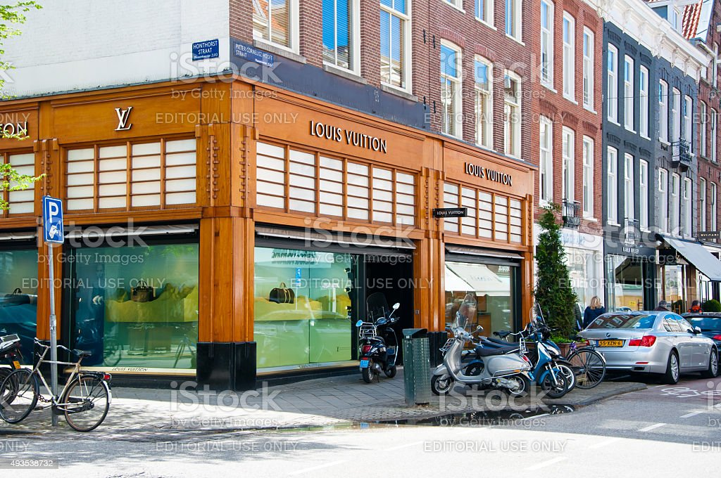Louis Vuitton store on the P.C.Hooftstraat shopping street in Amsterdam. stock photo
