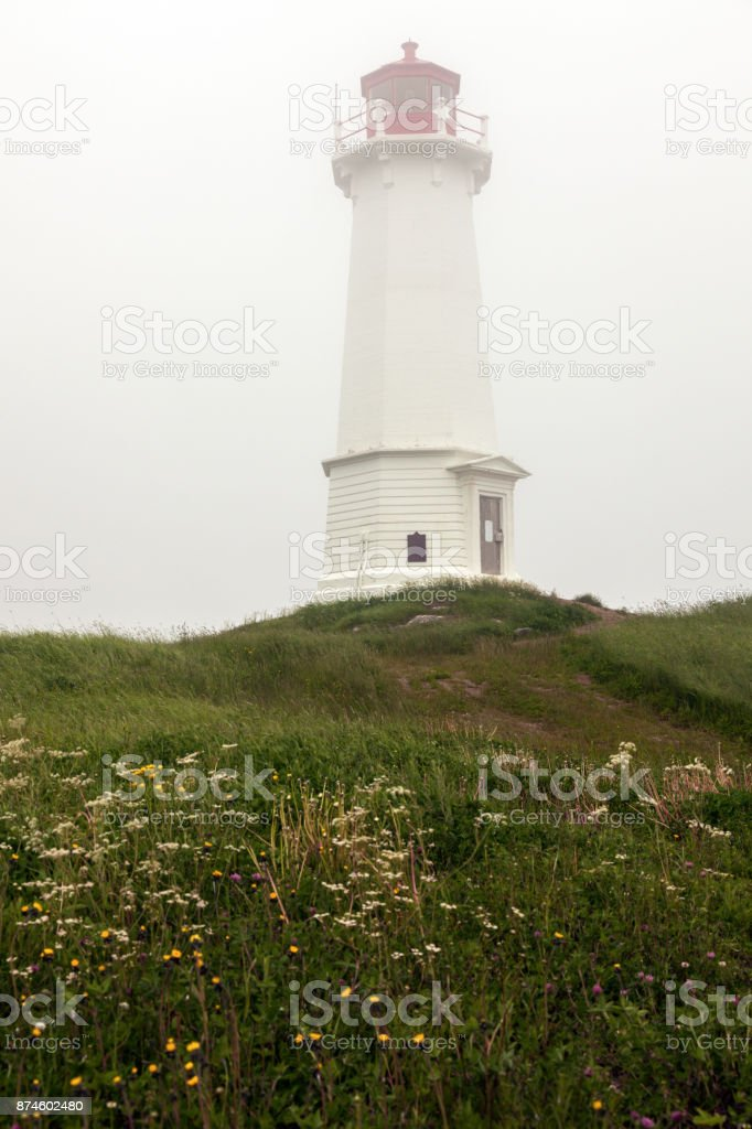 Louisbourg Lighthouse in Nova Scotia stock photo