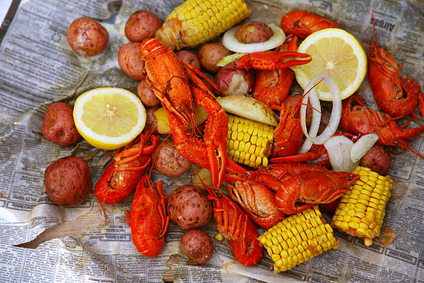 louisiana crawfish boil - caribbean food stock photos and pictures