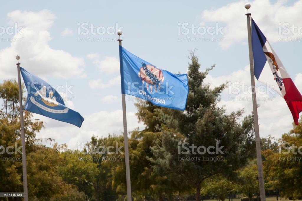 Louisiana, Oklahoma, and Iowa State Flags stock photo