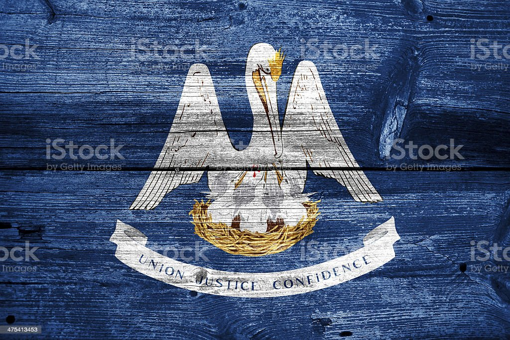 Louisiana State Flag painted on old wood plank texture royalty-free stock photo