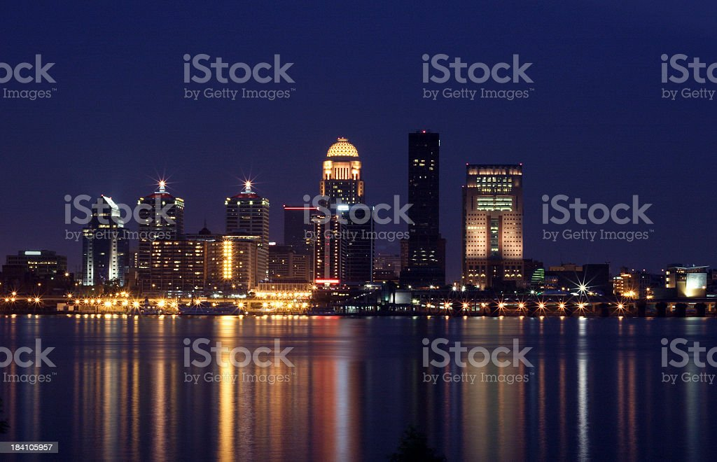 Louisville skyline as seen by the water at night stock photo