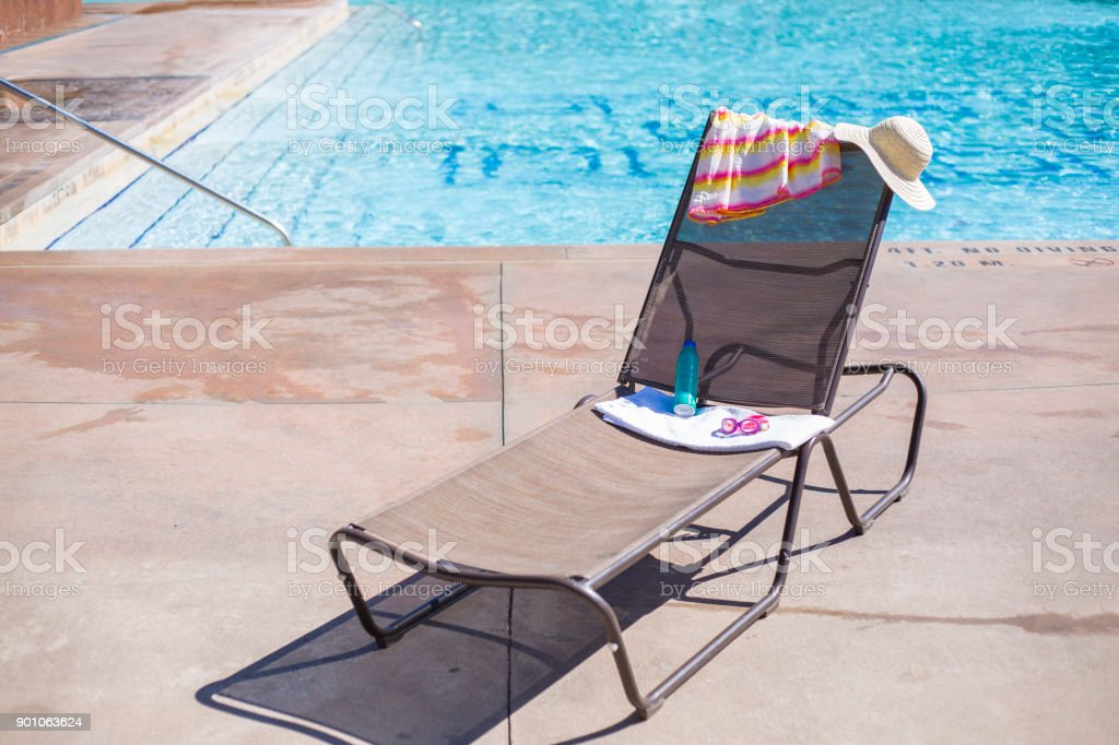 Suntan Lotion Swimming Pool Towel Swimming Goggles Pictures, Images And  Stock Photos