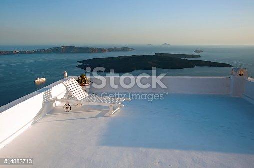 istock Lounge chair on the terrace in Fira, Santorini, Greece 514382713