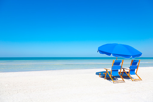 Lounge Chairs and Umbrella at the Beach
