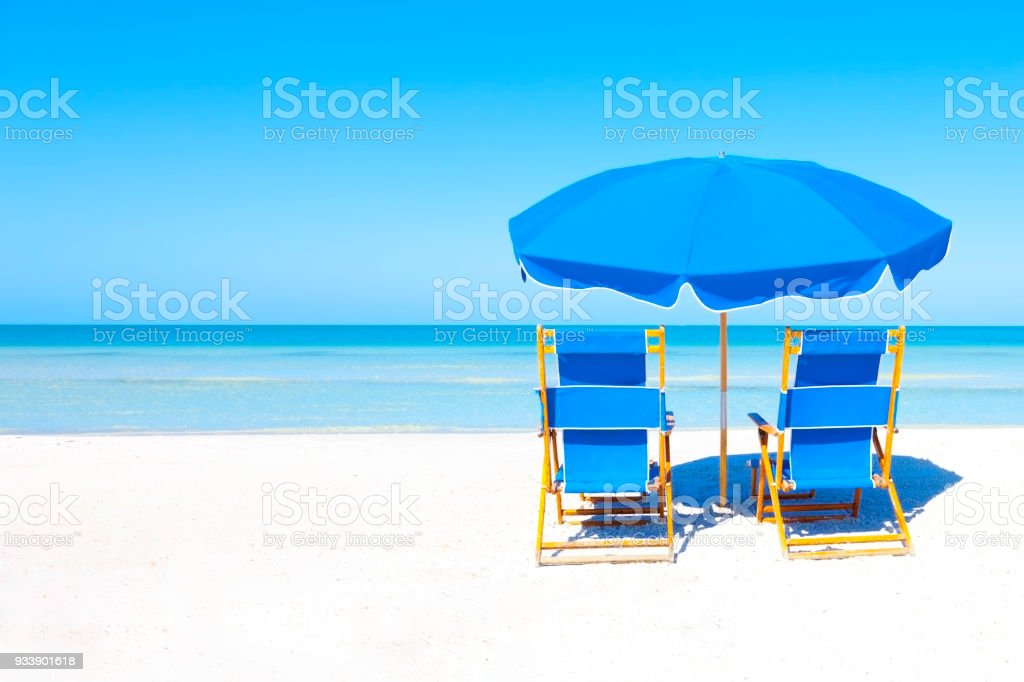 Lounge Chairs and Umbrella at the Beach - foto stock