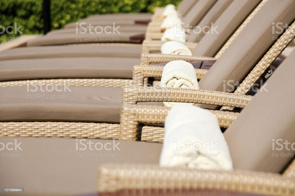 Lounge Chairs by the poolside royalty-free stock photo