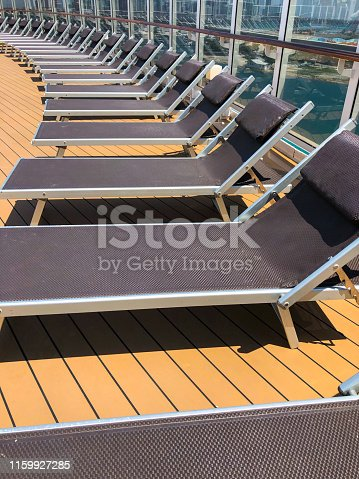 Lounge chairs on ship deck