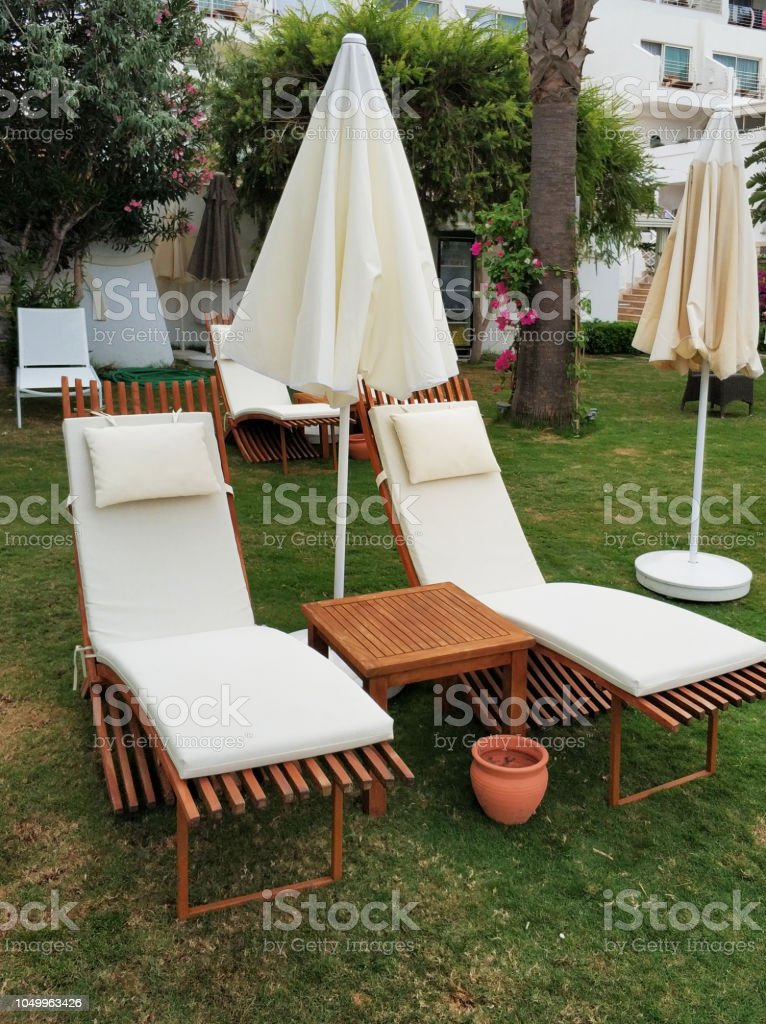 Lounge chairs in hotel garden