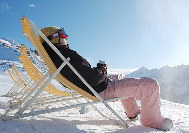 lounge chairs relaxing at ski resort apres ski stock pictures, royalty-free photos & images
