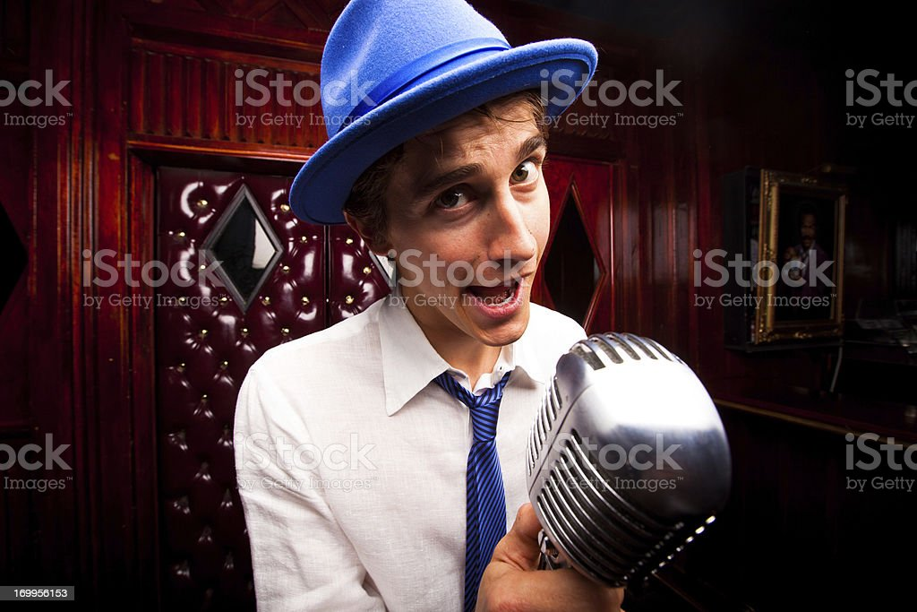 Lounge Singer with Microphone stock photo