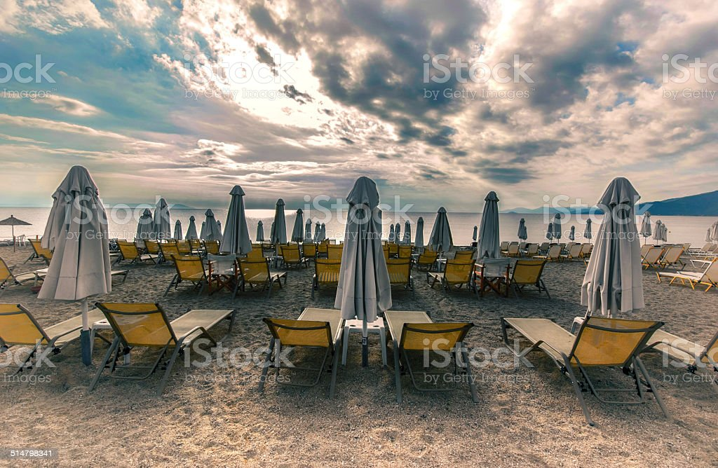 lounge sun bed and umbrella on tropical beach sunrise morning stock photo