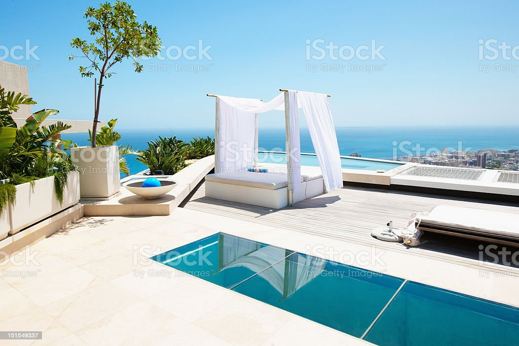 Lounge with a swimming pool and bed stock photo