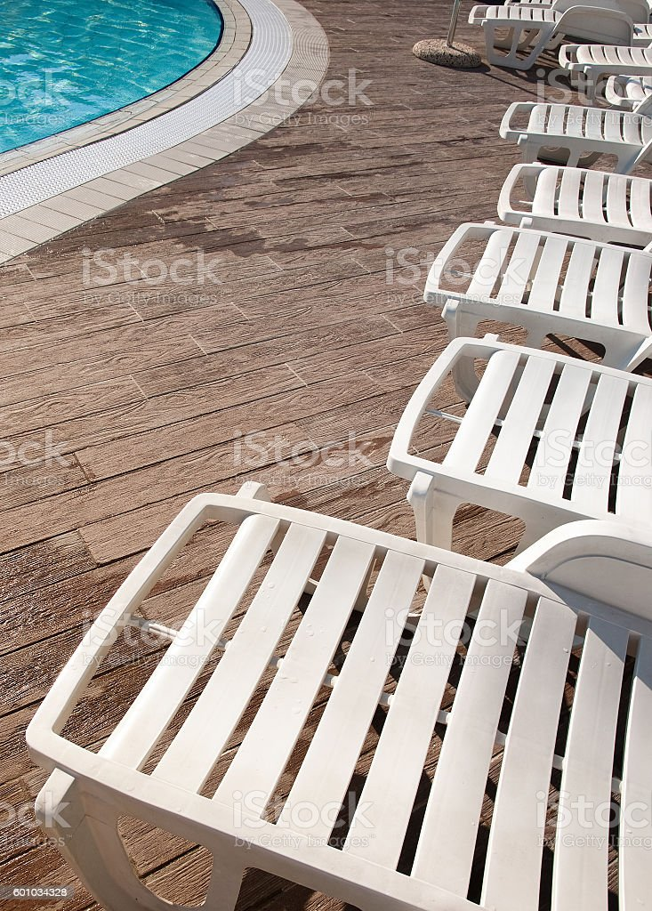 Loungers and pool stock photo