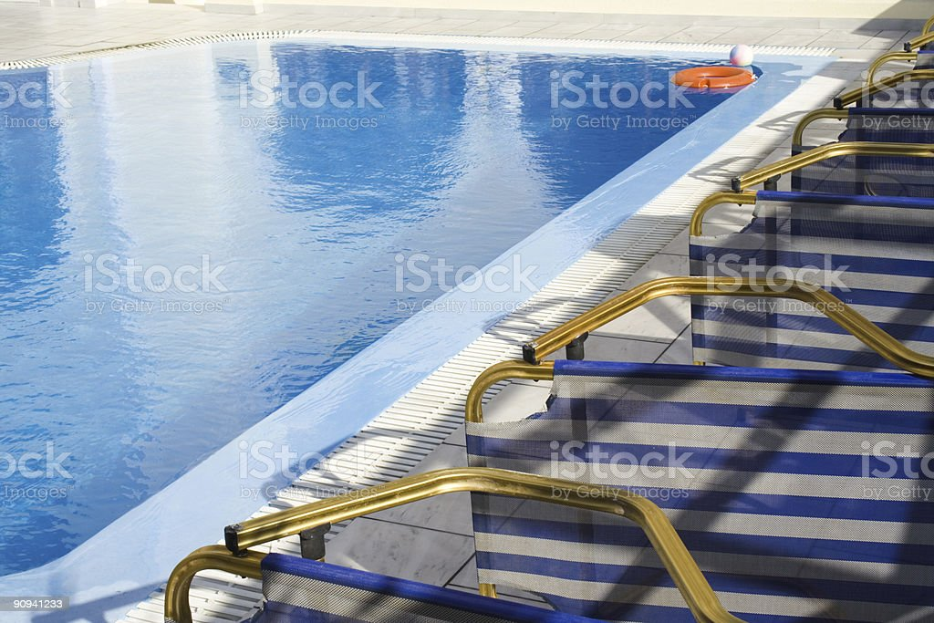 Lounges by swimming  pool stock photo