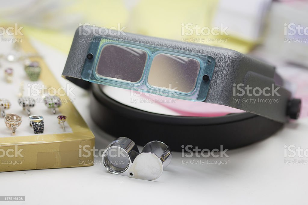 Loupe and Jewelers magnifying glass royalty-free stock photo