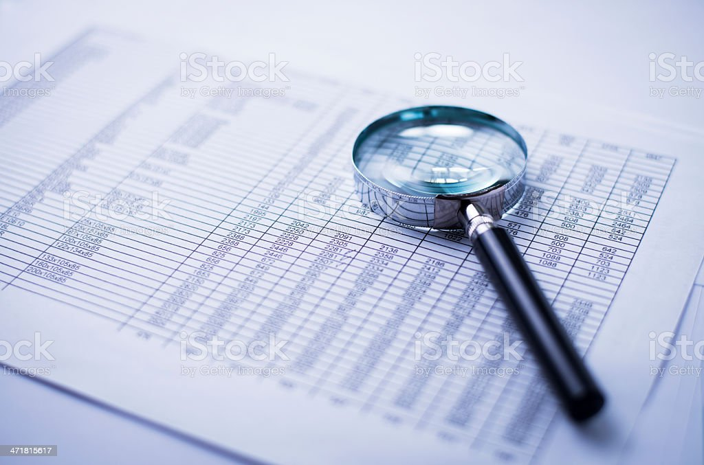 loupe and the financial report royalty-free stock photo