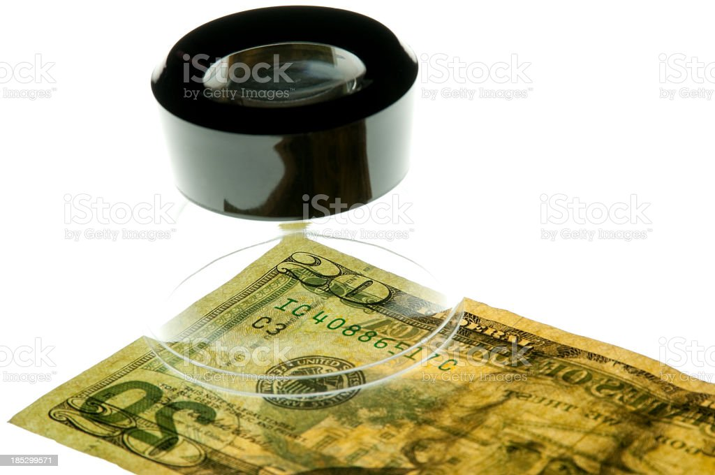 Loupe sitting on a twenty dollar bill royalty-free stock photo