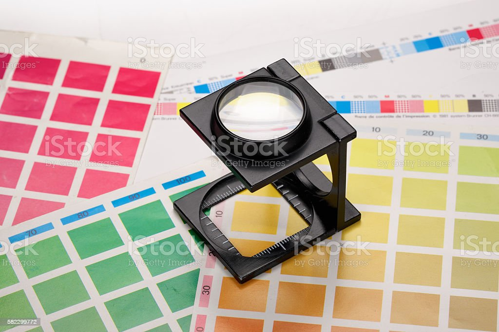 Loupe with CMYK color scales stock photo